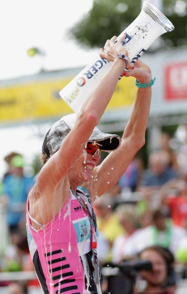 ROTH, GERMANY - JULY 17:  Second place Carrie Lester of Australia celebrates after the Challenge Triathlon Roth on July 17, 2016 in Roth, Germany. (Photo by Stephen Pond/Getty Images for Challenge Triathlon)